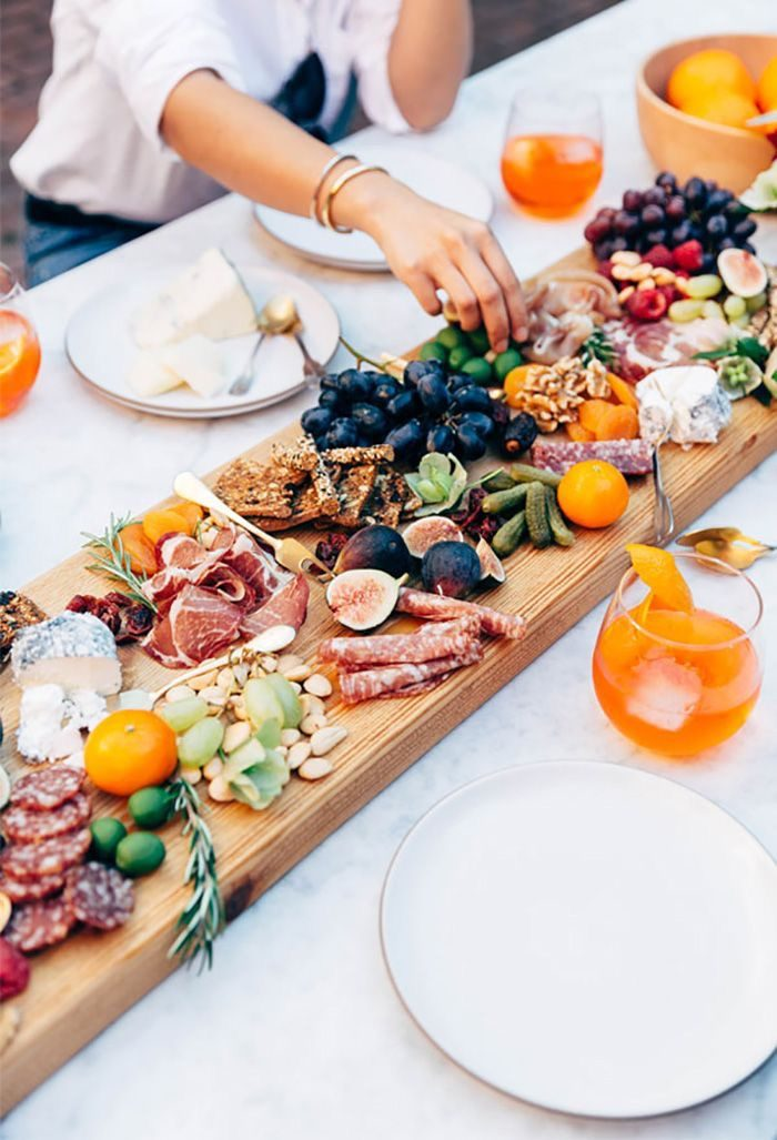 Charcuterie board entertaining delicious food